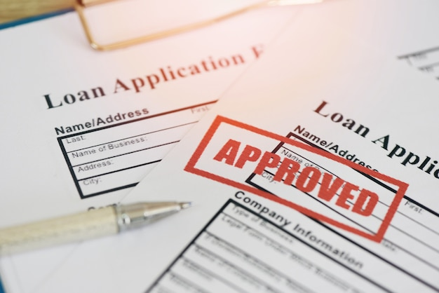 Loan application form with rubber stamping that says loan approved, financial loan approval