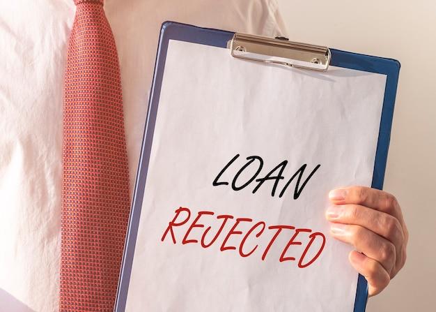 ローンは紙の碑文を承認しました。金融借入と貸付の概念。