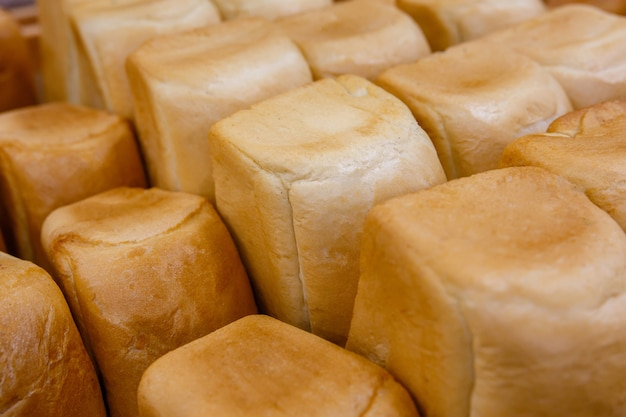 Loaves of bread on a shelf or display case in a store