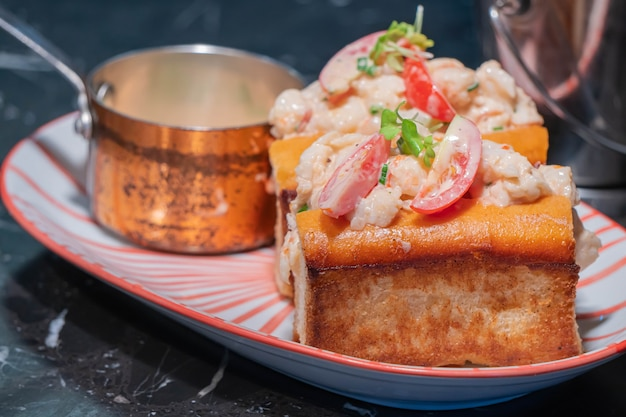 Lobster roll.fresh maine lobster boiled, mixed with mayo, celery, chives served in toasted hero roll with crisp lettuce and drawn butter.