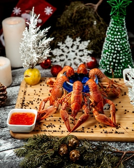 Lobster set with sweet chili on wooden desk