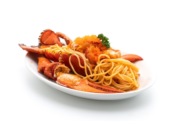 Lobster spaghetti with shrimp eggs isolated on white table