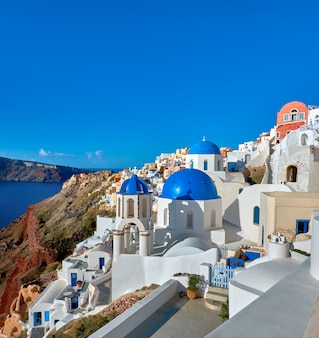Local church with blue cupola in oia, santorini, greece, panorama