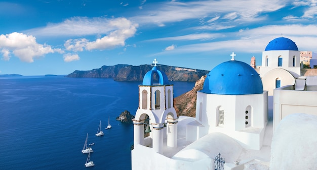Local church with blue cupola in oia, santorini, panorama