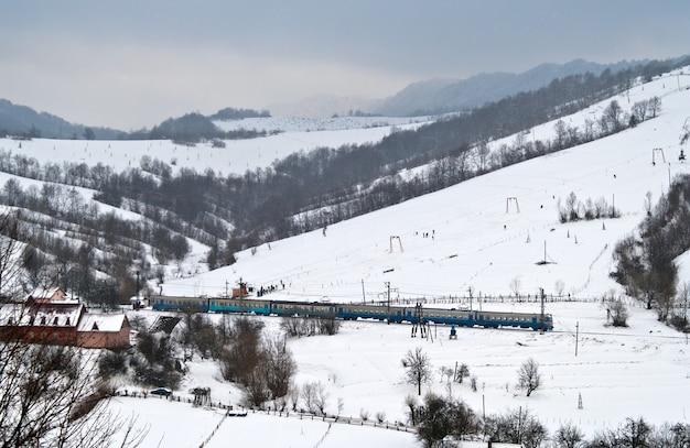 The local electric train passes the carpathians in ukraine