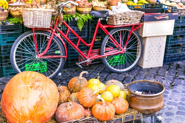 Local fruit market with old bicycle and pumpkins in campo di fiori in rome