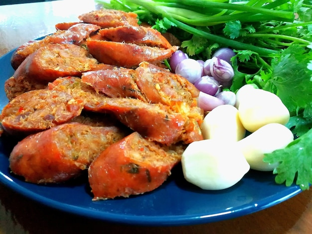 Local northern thai food  northern thai spicy sausage street food isolated in blue dish