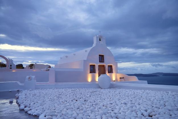 A local orthodox chapel in oia, santorini island, greece, at night