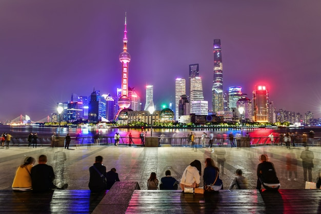 Local and tourists relaxing and sightseeing at huangpu riverside the bund in shanghai,china
