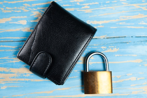 Lock and black wallet on the table