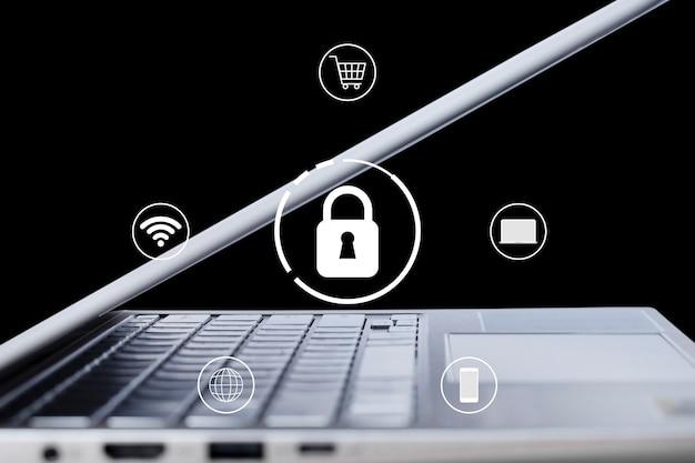 Технология безопасности значок замка с портативным компьютером на черном фоне