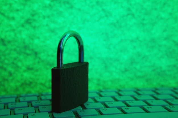 Lock the keyboard. cyber security concept on green background