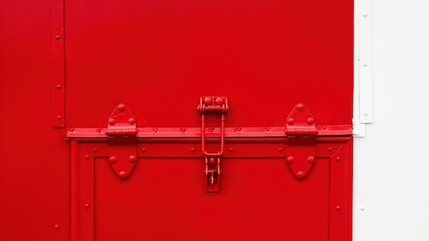 Lock system on metal plate in red and white colors