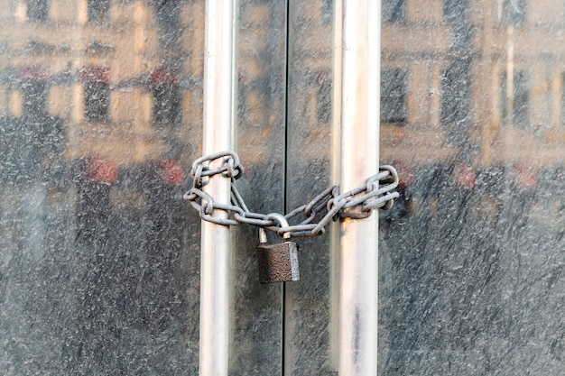 Lockdown shop market closed due to coronavirus pandemic door locked with chain