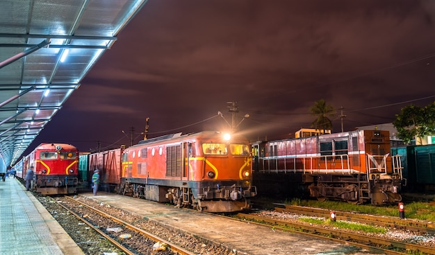 Locomotives with a passenger and a freight trains at da nang station in vietnam