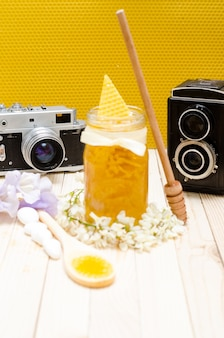 Locust honey retro jar with locust blossoms, and small white stones