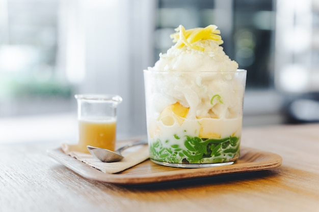 Lod chong, thai melon, puffed rice with coconut snow ice topping with sliced jackfruit.