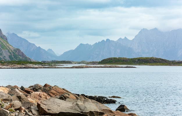 Lofoten stony fjord and mountains summer cloudy landscape, norway.