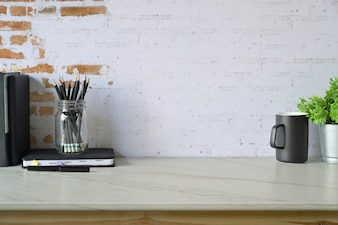 Loft contemporary workspace with home office supplies and copy space.