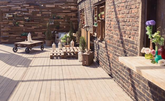 Loft garden design of veranda. wooden decorations. green plants