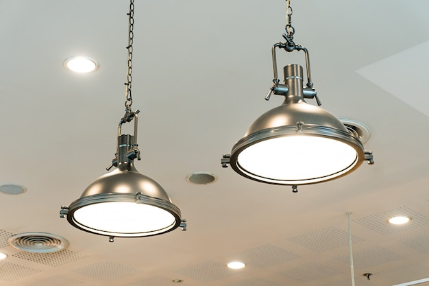 Loft industrial lamps against in coffe cafe.