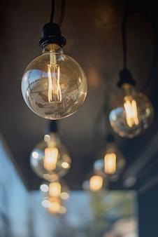 Loft round light bulbs on black wires