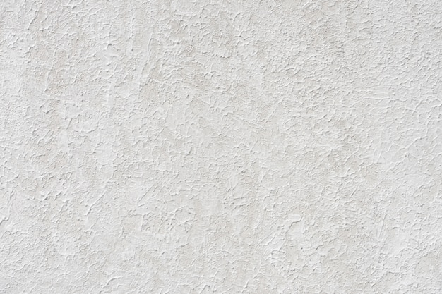 Loft-style plaster walls, gray, white, empty space used as wallpaper.