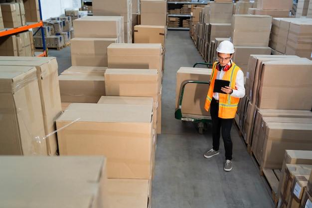 Logistic worker delivering boxes
