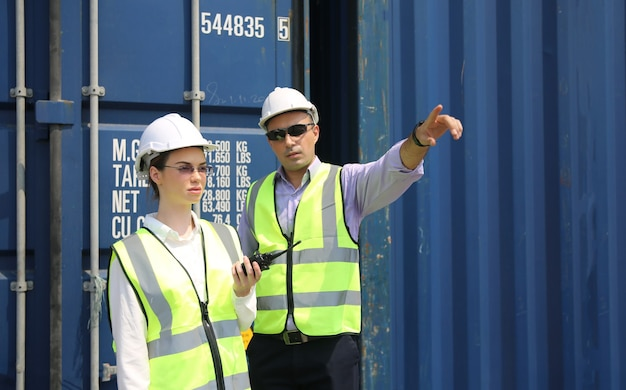 Logistics engineer control at the port, loading containers for trucks export and importing logistic concept