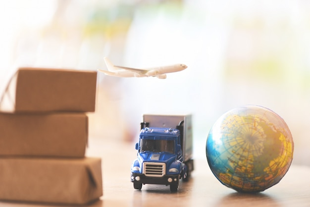 Logistics transport import export shipping service customers order things from via internet international shipping online air courier cargo plane boxes packaging freight forwarder to worldwid
