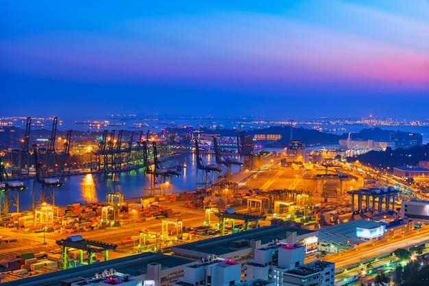 Logistics and transportation shipyard at twilight time.