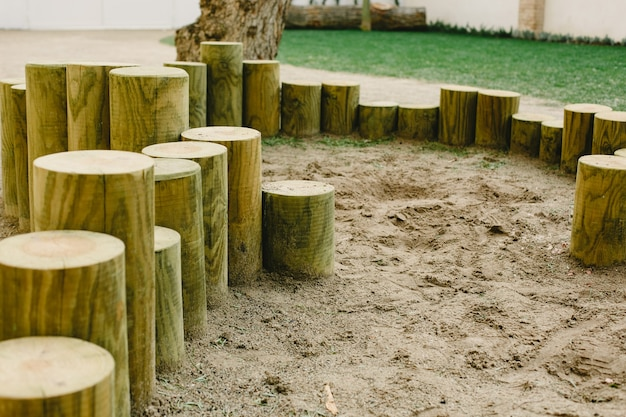 Logs and wooden sticks installed in a school for the children's game