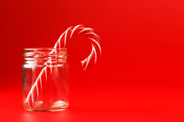 Lollipop candy cane in a glass jar