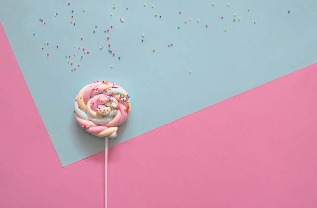 Lollipop on pastel background.