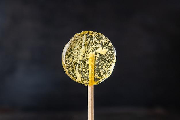 Lollipop sweet candy on stick transparent caramel sugar dessert handmade fresh meal snack