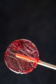 Lollipop transparent sweet caramel sugar on stick dessert handmade fresh portion ready to eat meal
