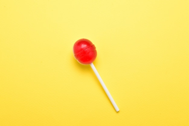 Lollipop on a yellow background. space for text or design.