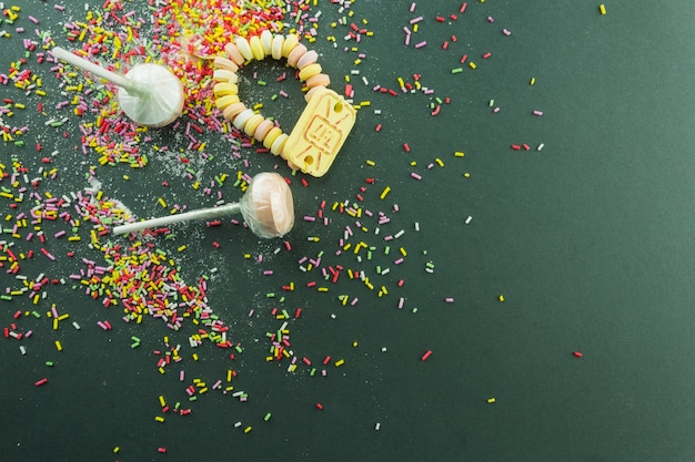 Lollipops and candies on sprinkles