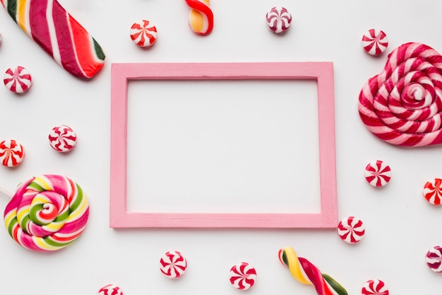 Lollipops and candies with frame and copy space
