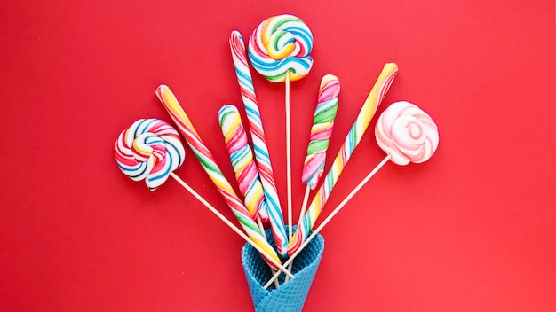 Lollipops and candy sticks in cone