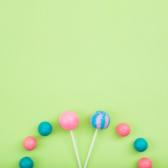 Lollipops and sweetmeats on aligned on table
