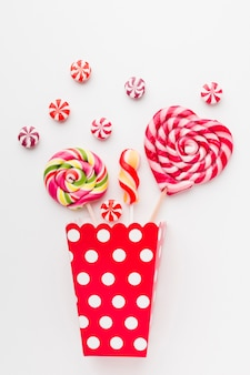 Lollipops and sweets in popcorn bag