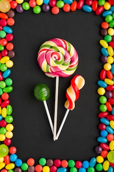 Lollipops with delicious sweets frame
