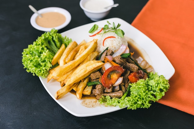 Lomo saltado with peruvian sauce and garlic sauce