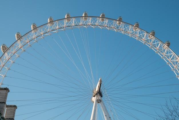 London eye ferris wheel with a blue sky.