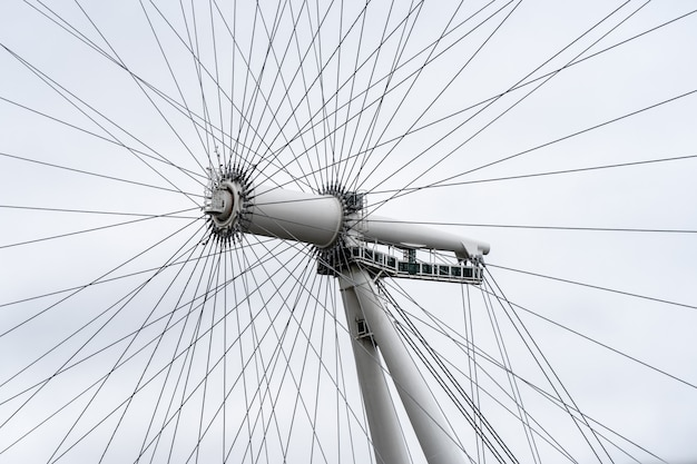 The london eye is a cantilevered observation wheel on the south bank of the river thames in london