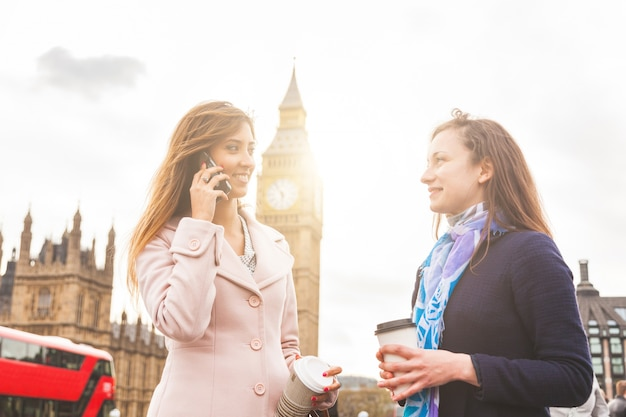 London, two women standing with big ben on background