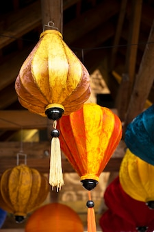 London, u.k. july 22, 2021: paper colorful chinese lanterns hanging in london zoo park, street decoration