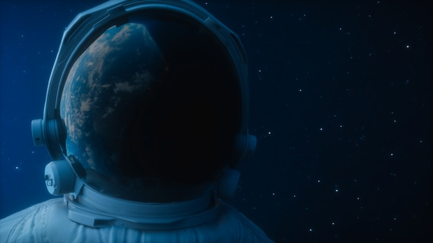 A lone astronaut looks at the planet earth in orbit in outer space