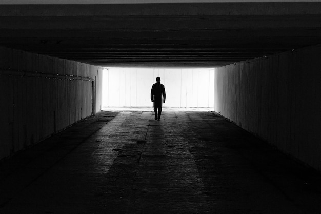 A lone man goes as a symbol of the path and the unknown